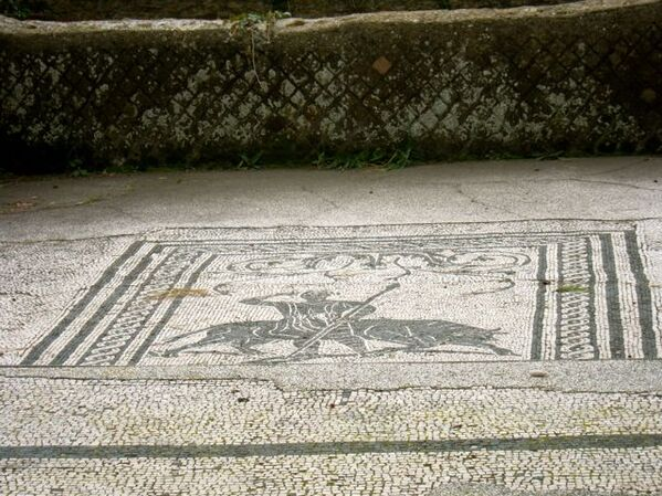 Mosaic of a Hunter and Wild Animal in Ostia Antica.