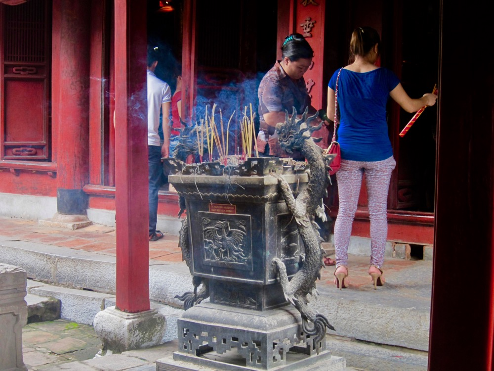 Worshippers in the Temple of Literature in Hanoi